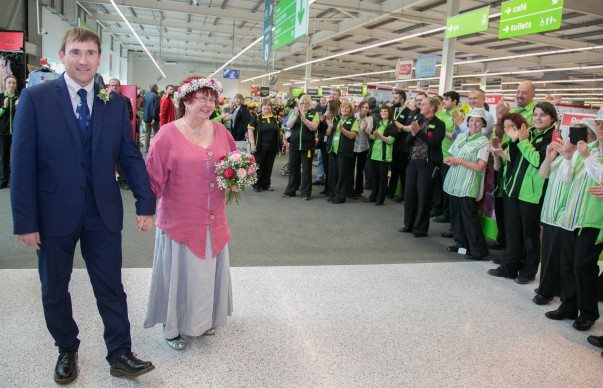 Colleagues at Asda Rawtenstall applaud the newlyweds into the store