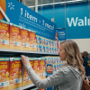 """Woman shopping in store during """"Fight Hunger Spark Change"""""""
