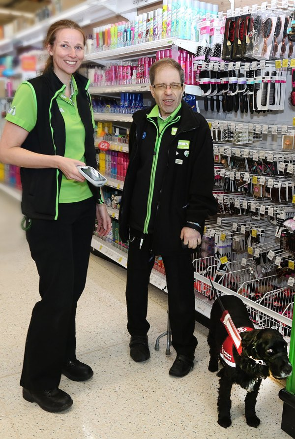 Asda Biggleswade colleagues Helen Jackson and Russell Bryant with Russell's hearing dog Ben