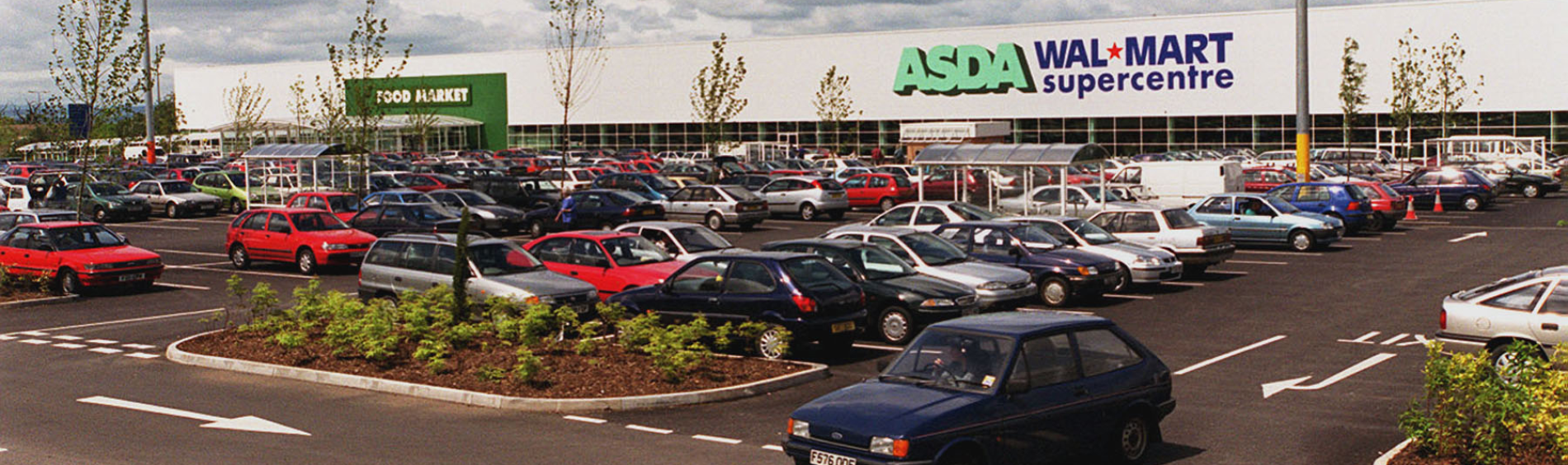 Older Asda store exterior and late 80's-90's cars in the car park