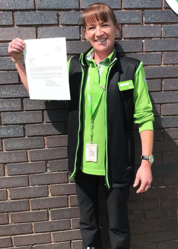 Lynn Bryce from Asda Newquay with her letter of thanks from the US Embassy