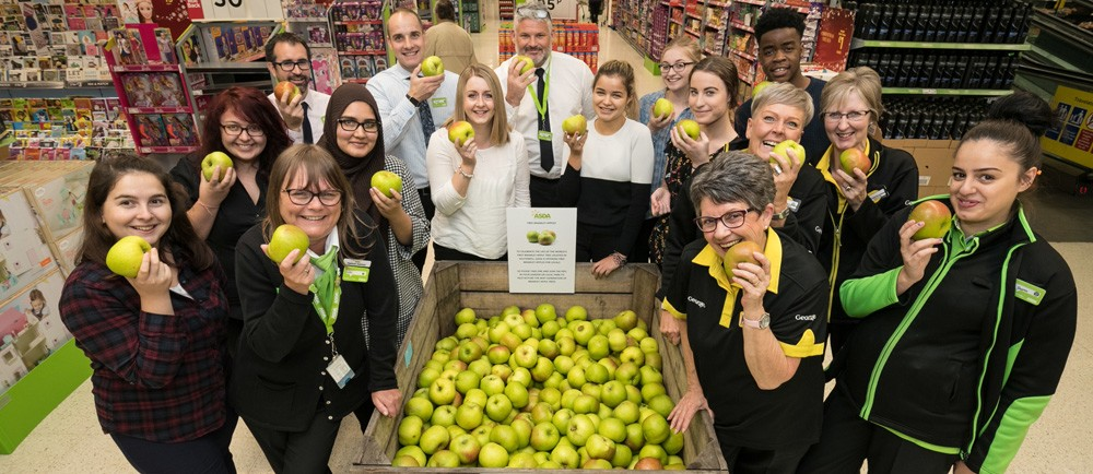 Colleagues at Asda West Bridgford give away free Bramley apples