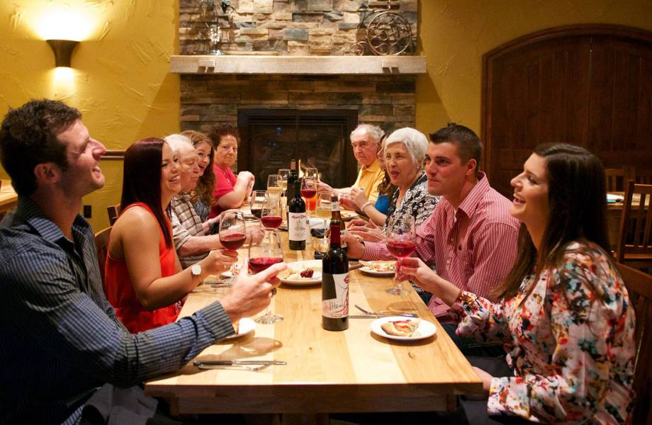 Family around a table enjoying RedHead Wine
