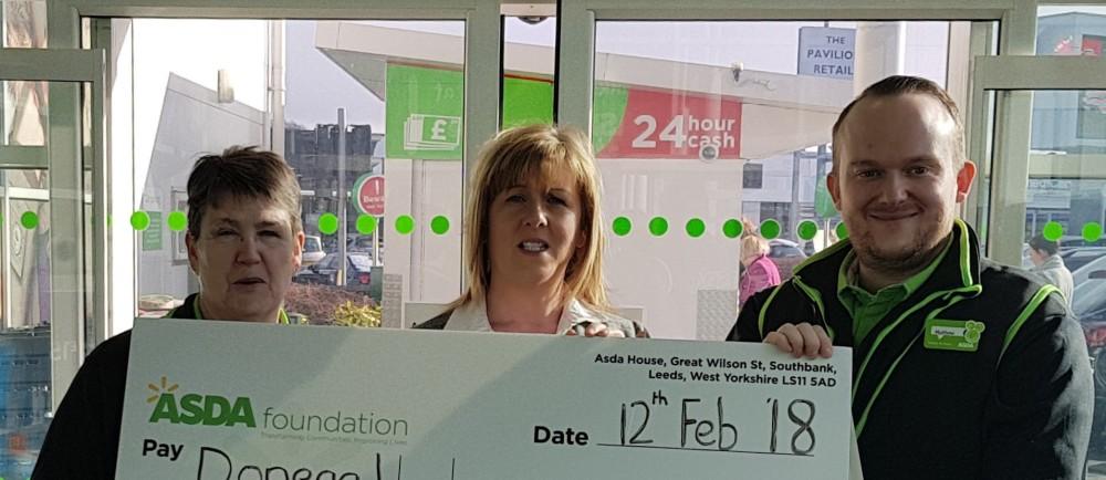 Donegal Hospice receives Green Token Giving donation at Asda Strabane