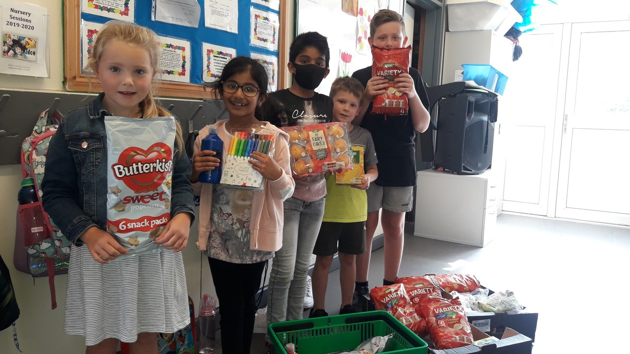 Donation to the children of Walsgrave C of E primary school | Asda Coventry