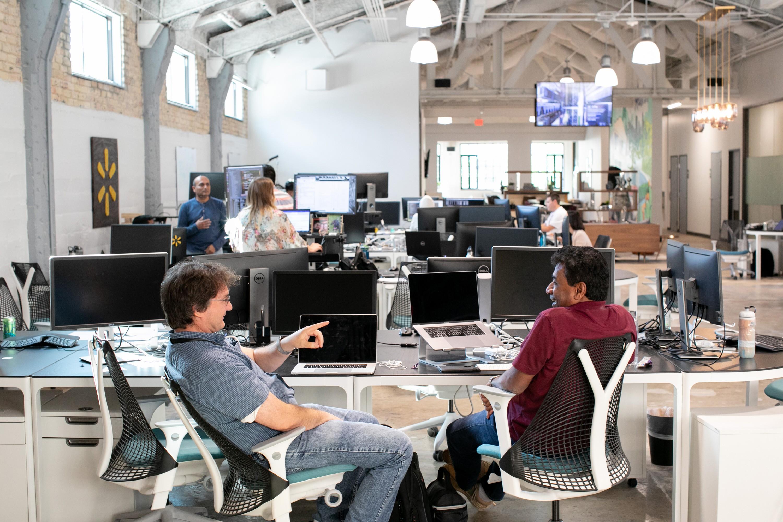 Two associates talk at the new Walmart tech headquarters in Austin, Texas