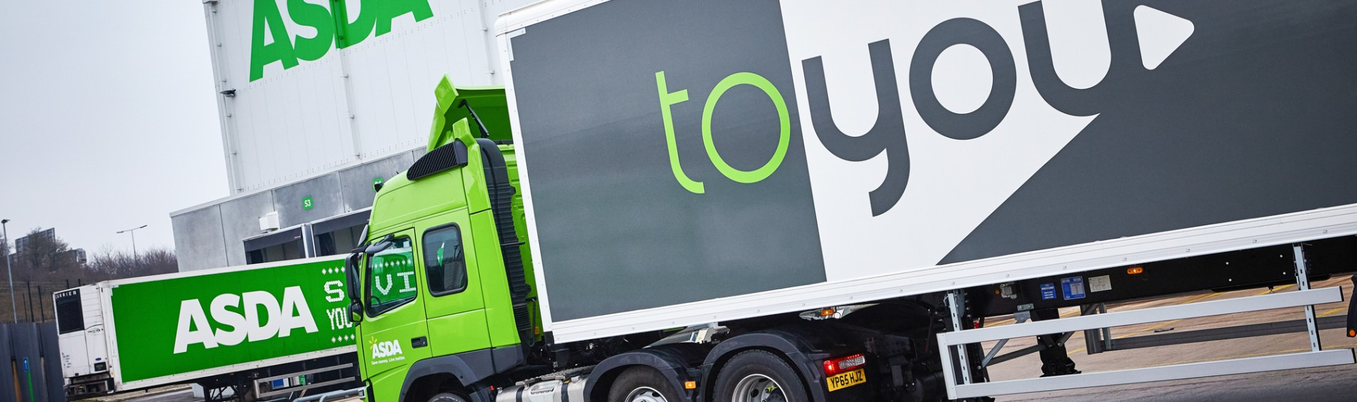 A semi-truck has the toyou logo on the side