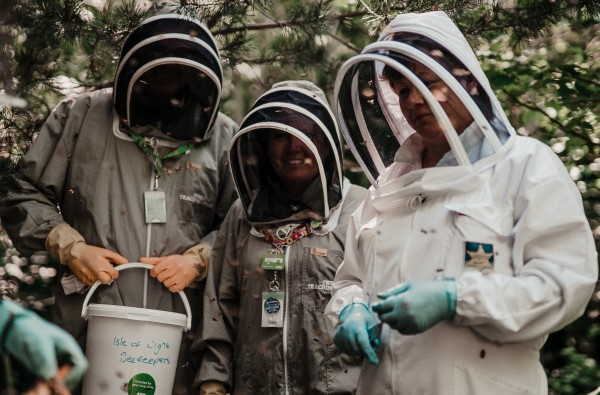 Asda Newport colleagues Kenny Farrell and Clare Jones with the beekeepers