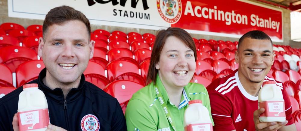 Asda Accrington colleague Sarah Worden with Accrington Stanley players Billy Kee and Kayden Jackson
