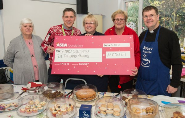 Bridget and Chris from Asda Greenhithe present the cheque