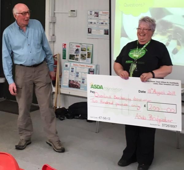 Bridgwater community champion Jo presenting a cheque