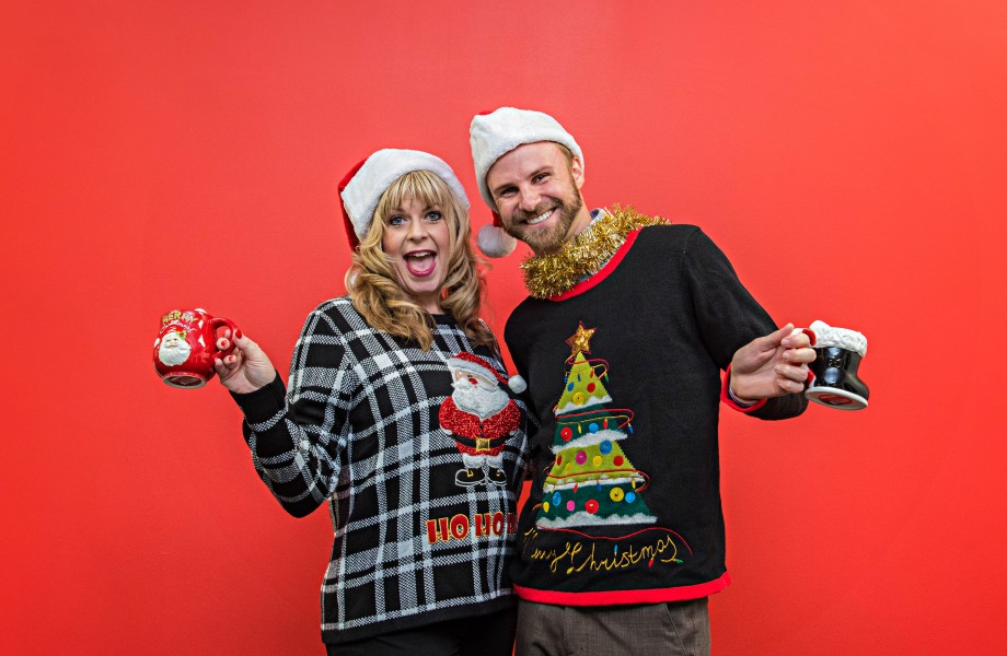 Man and woman wearing ugly Christmas sweaters