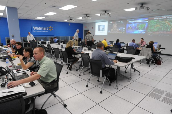 Walmart's Emergency Operations Center is filled with associates working on computers