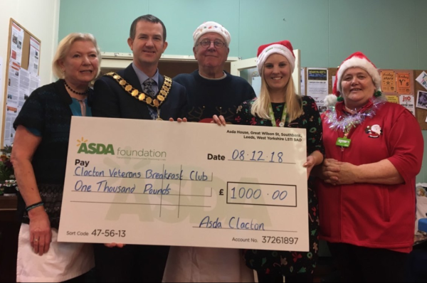 Amy Openshaw from Asda Clacton presenting a cheque to The Veterans Breakfast Club