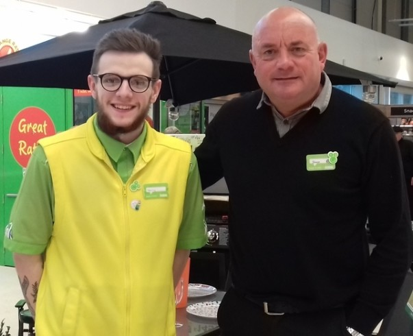 Asda Wrexham colleague Harry Jones with general store manager Shaun Leech