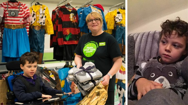 Kath from Asda Llandudno gives Alfie his new pyjamas
