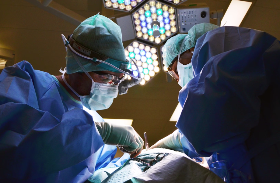 Two doctors perform a surgery