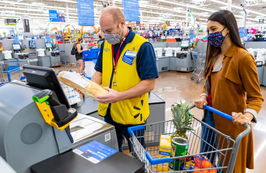 Associate Helping Customer at Self Checkout