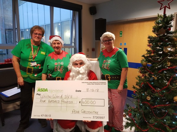 Bridget Sparks from Asda Greenhithe presents a cheque to the Willow Ward at Darent Valley Hospital