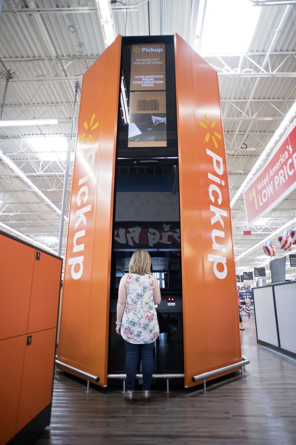 A customer approaches a Walmart Pickup Tower