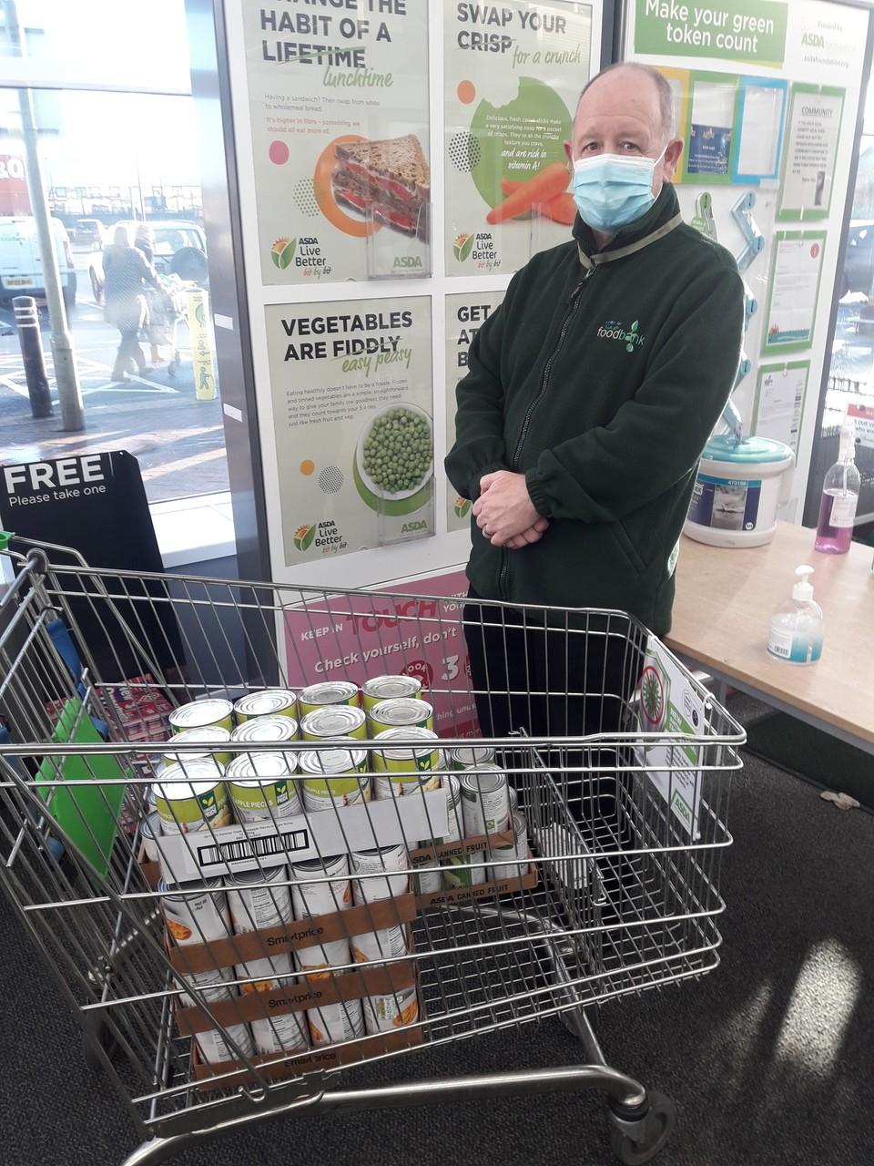 Tins of fruit for local food bank | Asda Leigh