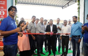 Men and Women cut giant ribbon