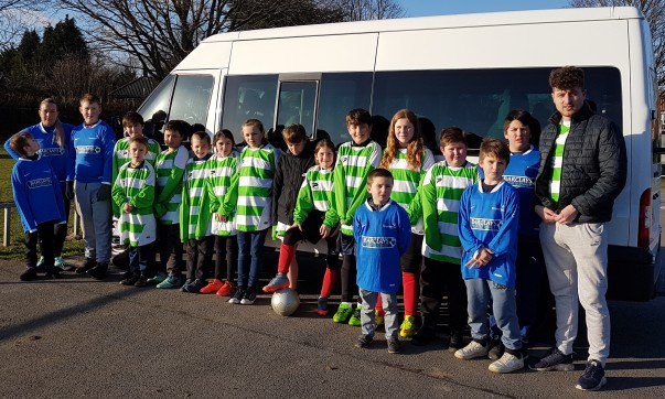 Young footballers next to the minibus paid for by an Asda Foundation donation
