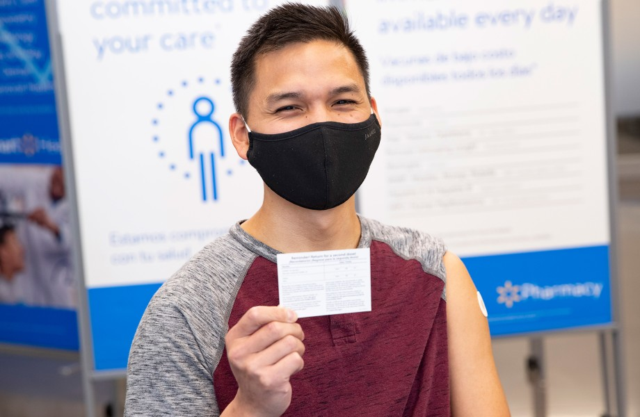 Custom holding COVID-19 Vaccination Record Card