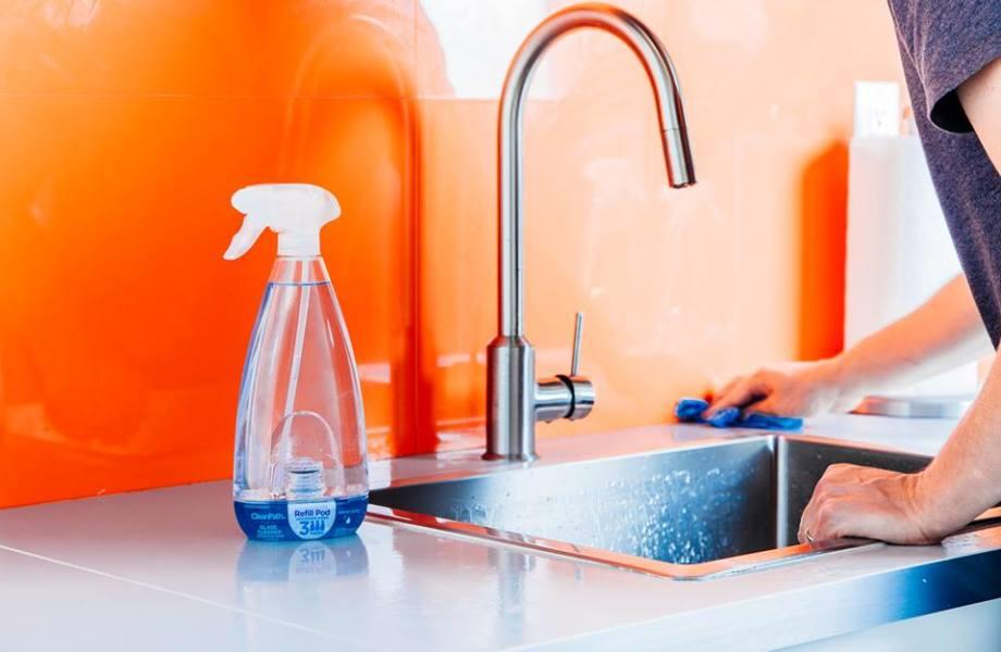 Clean Path Spray on Sink with Orange Background
