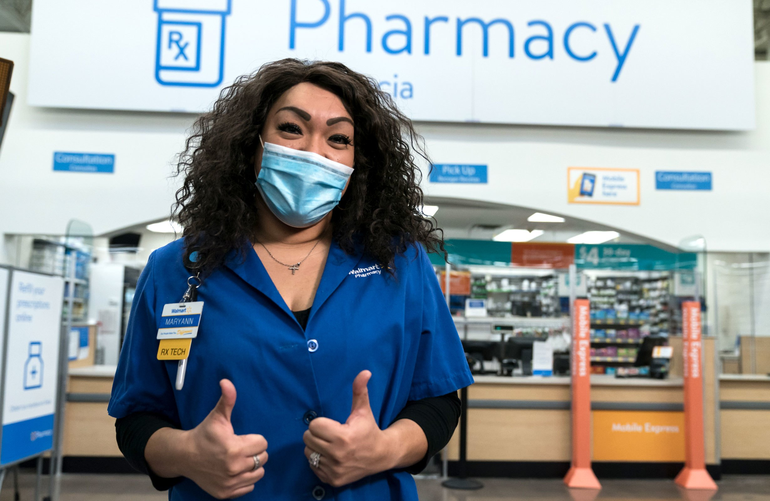 Pharmacy Tech in Front of Pharmacy with Sign in Background