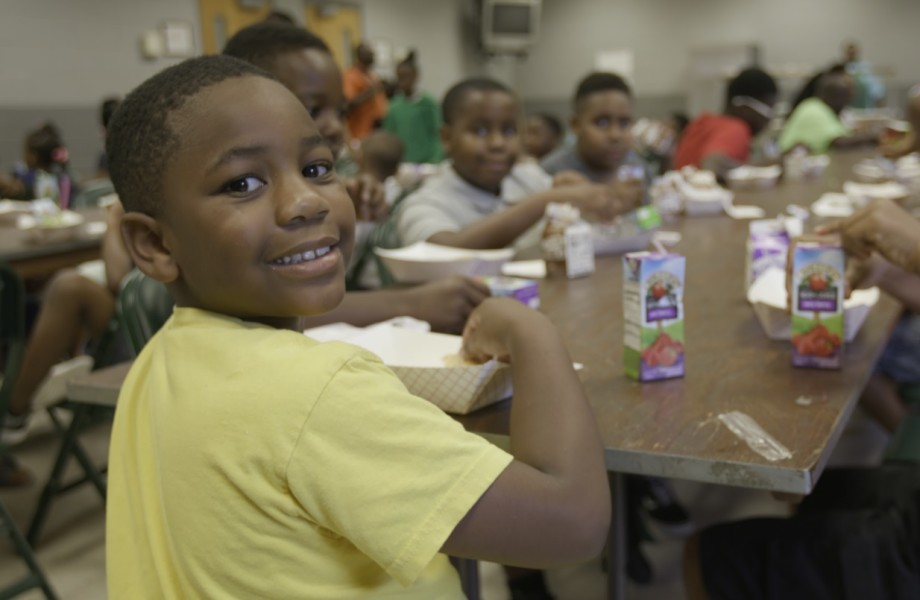 A camper enjoys breakfast at the G.W. Henderson Community Center in Tunica, Mississippi