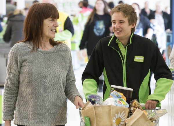 Asda Chatham colleague Joe helping customer Elaine Johnson