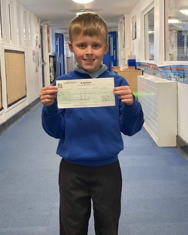 The Grange First School is over the moon with Asda's £800 cheque | Asda Gosforth