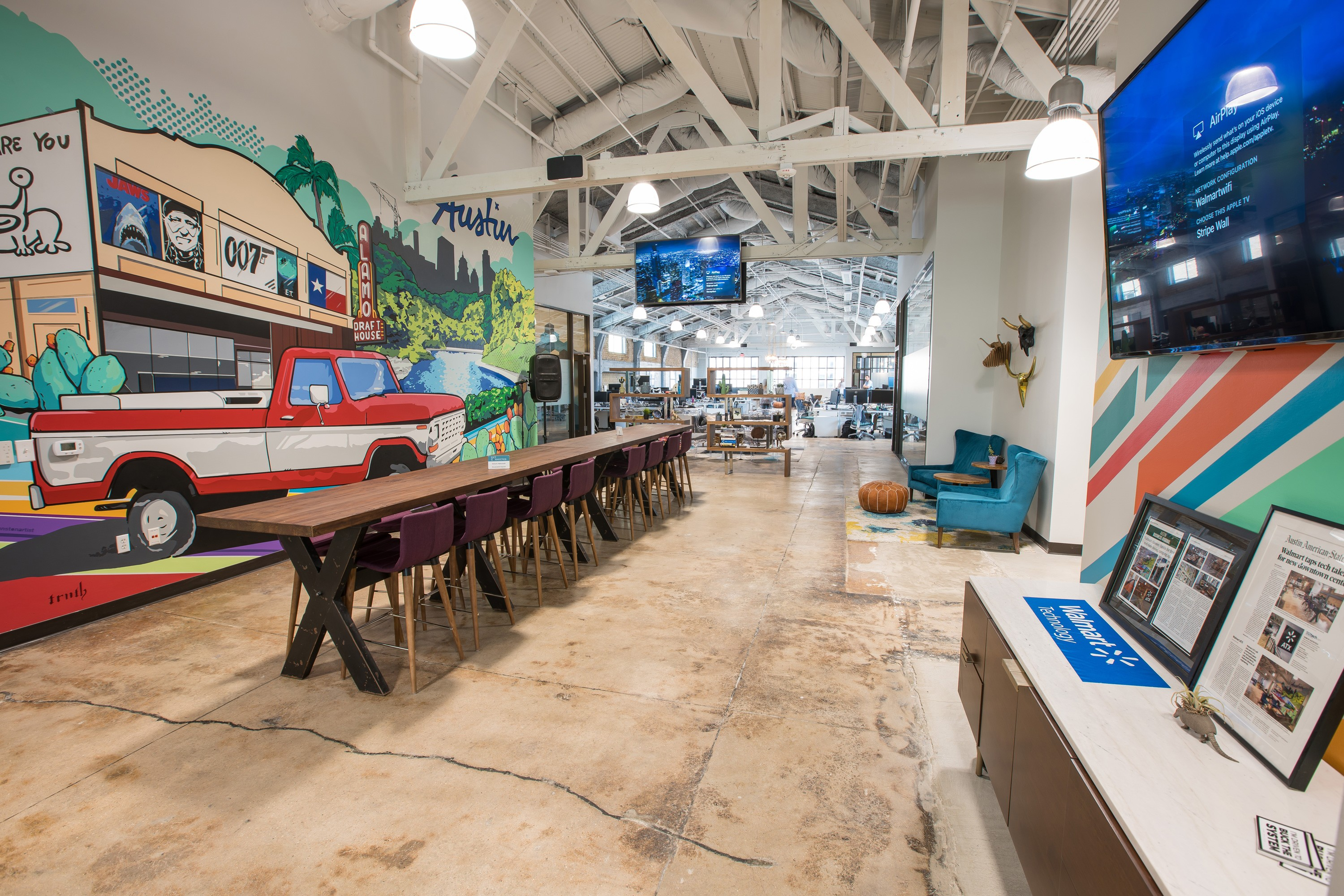 """A mural of Sam Walton's red pickup truck, the Austin skyline and the Alamo Drafthouse by Mike """"Truth"""" Johnston in the new Walmart tech headquarters in Austin, Texas"""
