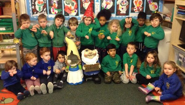Tidbury Green Private Nursery pupils with the damaged Asda giant gnomes