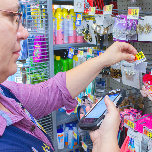 An associate uses the Price Change app on a mobile device