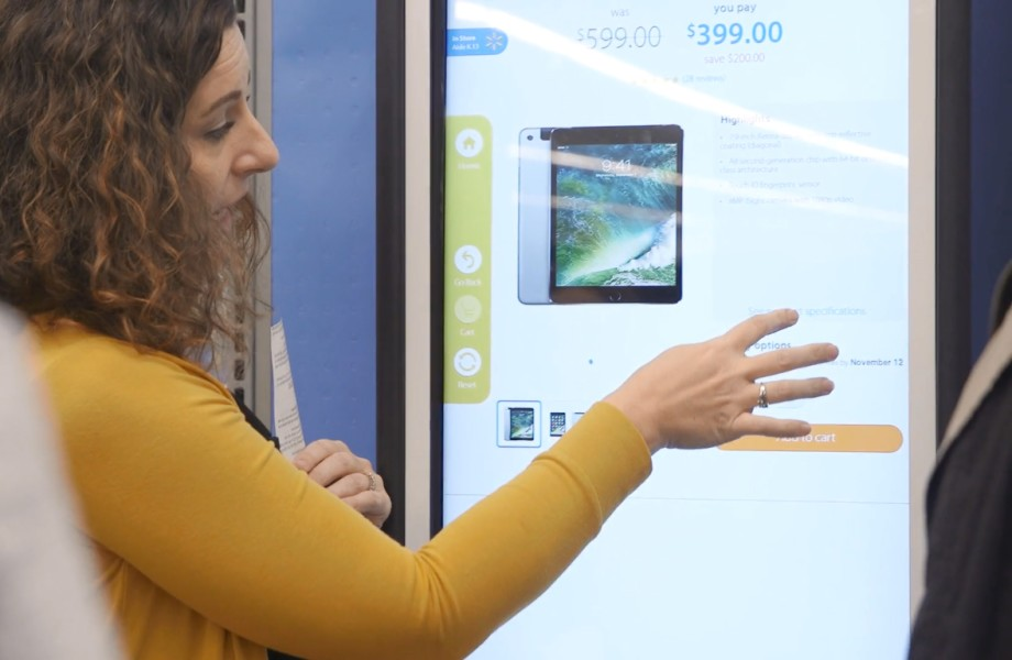 A customer uses a Walmart.com in-store kiosk