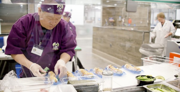 Cooks preparing food at the Sam's Club Sushi Bar