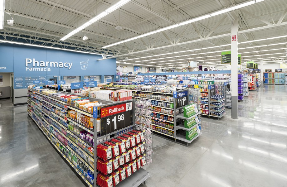 Aises of health and wellness products are inside a Walmart store