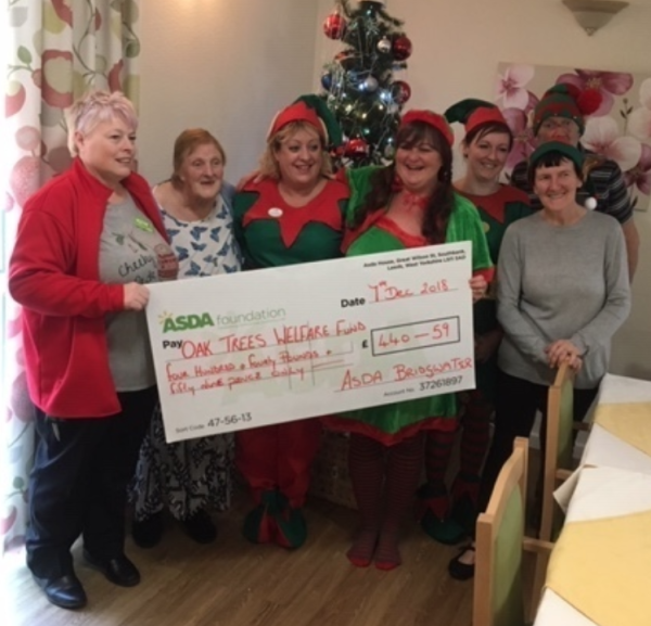 Jo Thexton from Asda Bridgwater presents a Christmas grant to Oak Trees Care Home