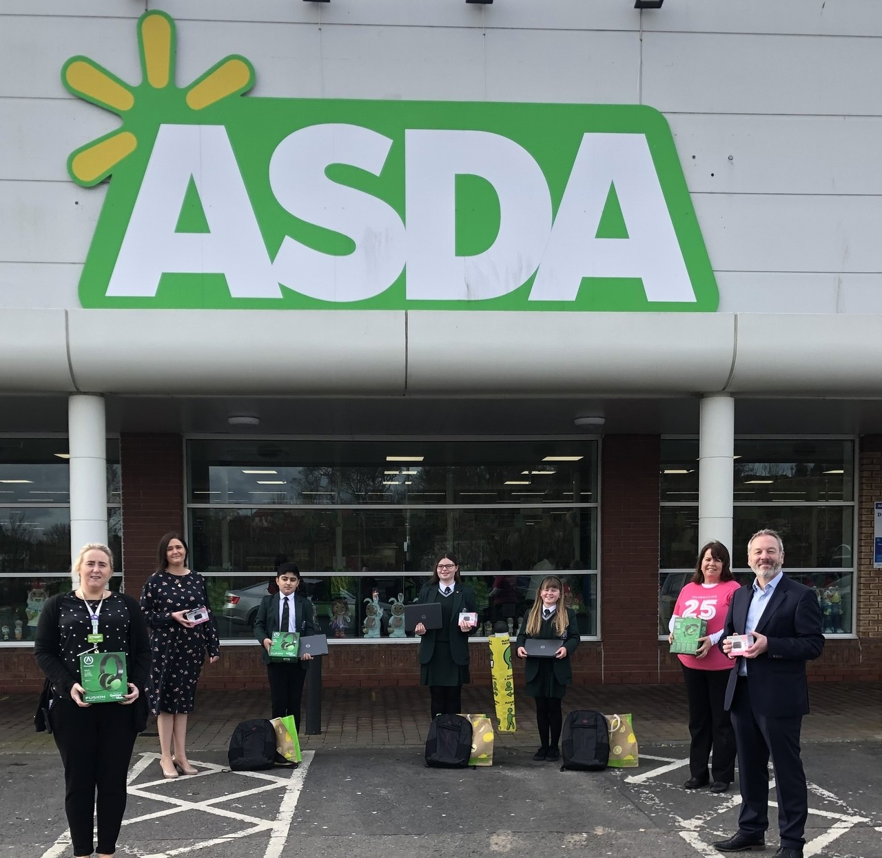 Laptop donation to St Colmcille's High School | Asda Downpatrick