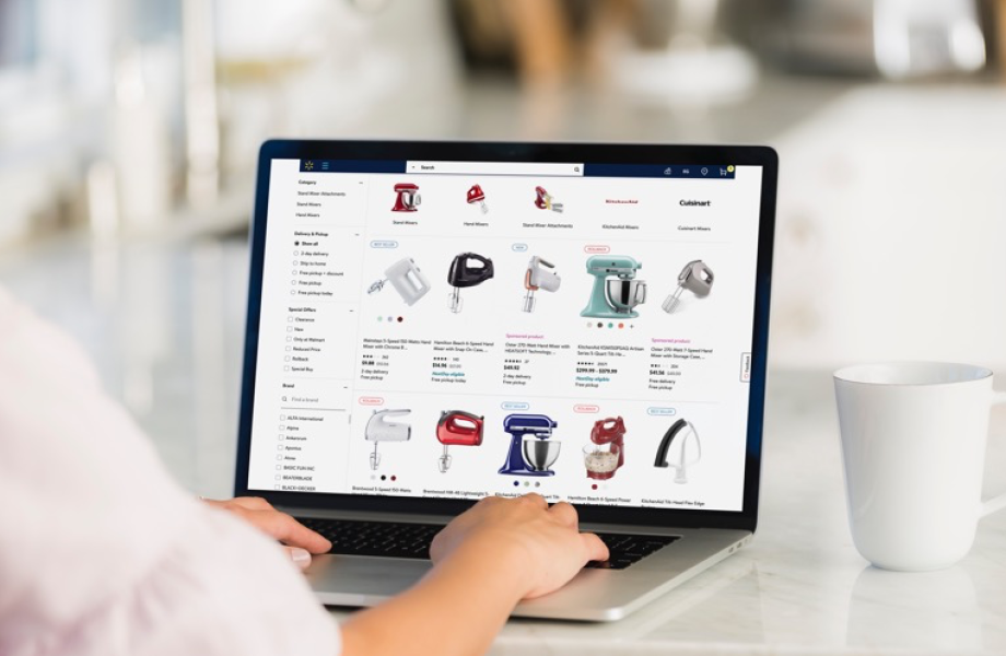 Customer shopping on Walmart.com with laptop