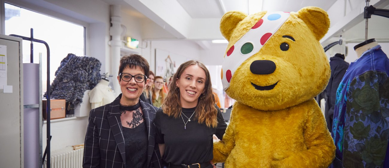 Fashion graduate Megan Grinham with Pudsey Bear