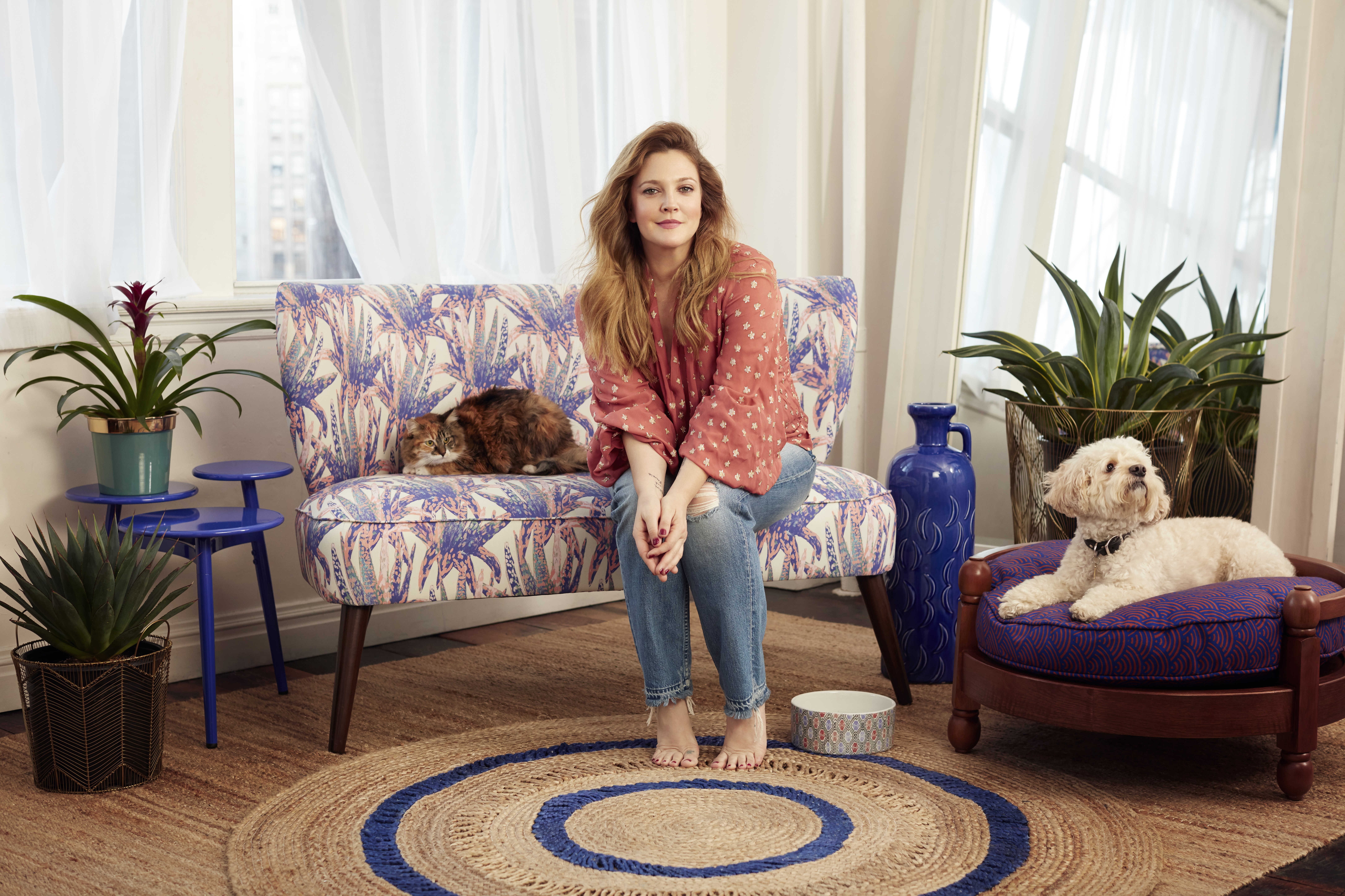 Drew Barrymore poses with items from her new Flower Home collection