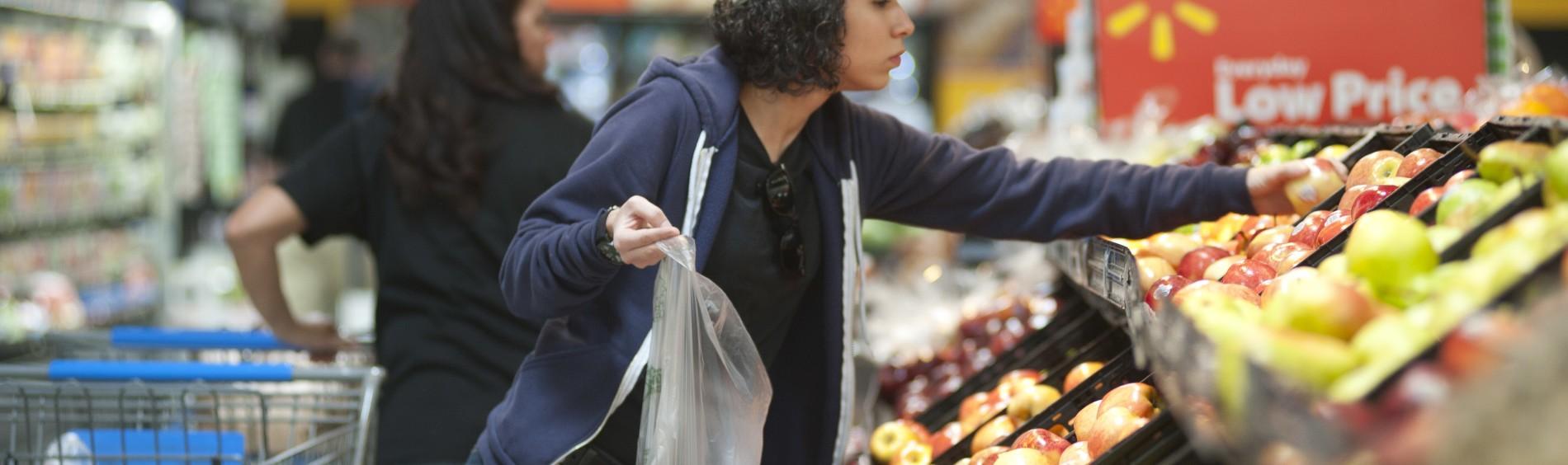 A Walmart customer shops for fresh produce