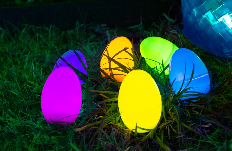 LED Easter Eggs and basket sitting on grass at night