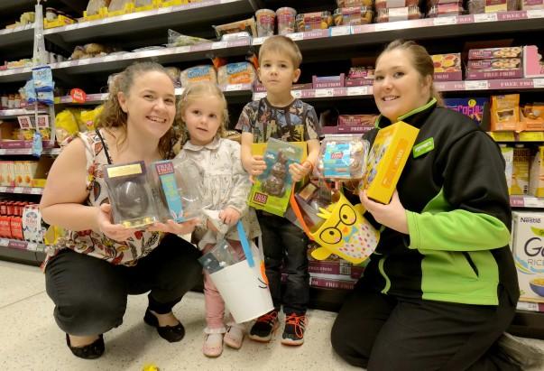 Asda Stockton community champion Michaela hands over some dairy free Easter treats