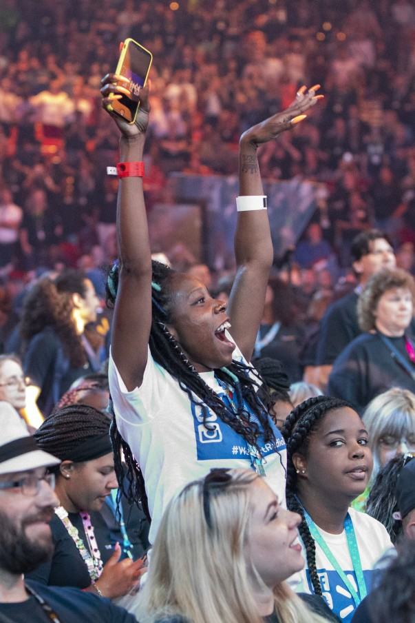An associate cheers during the Walmart U.S. Associate Meeting at Shareholders 2018