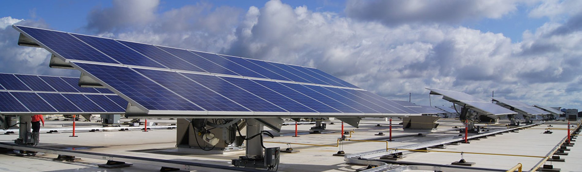 Industrial sized Solar panels on rooftop point skyward