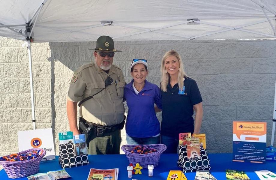 Gina at Walmart booth about Drug Awareness with local Sheriff